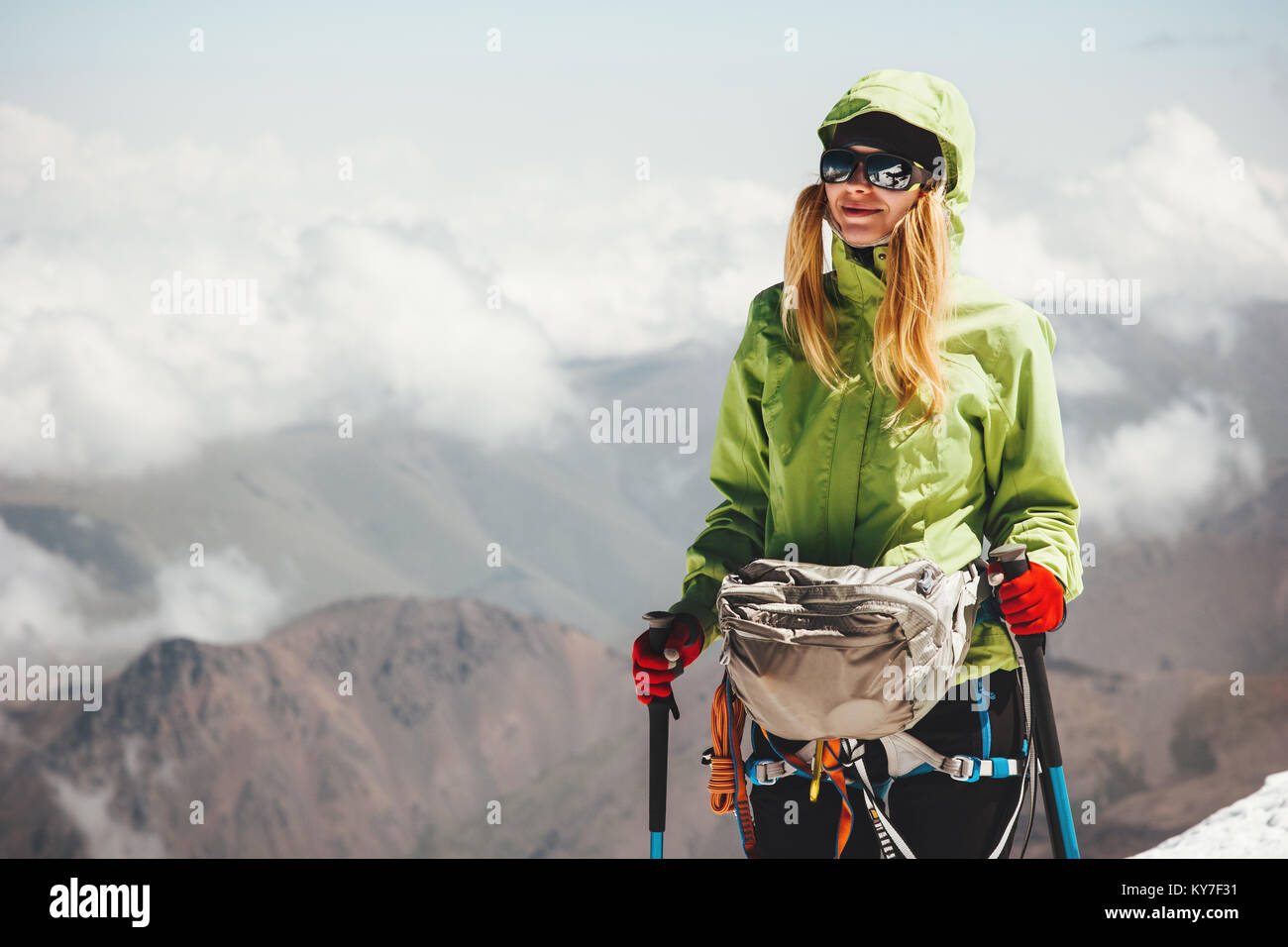 Woman climbing on mountain summit Travel Lifestyle adventure concept active vacations outdoor mountaineering sport - Stock Image