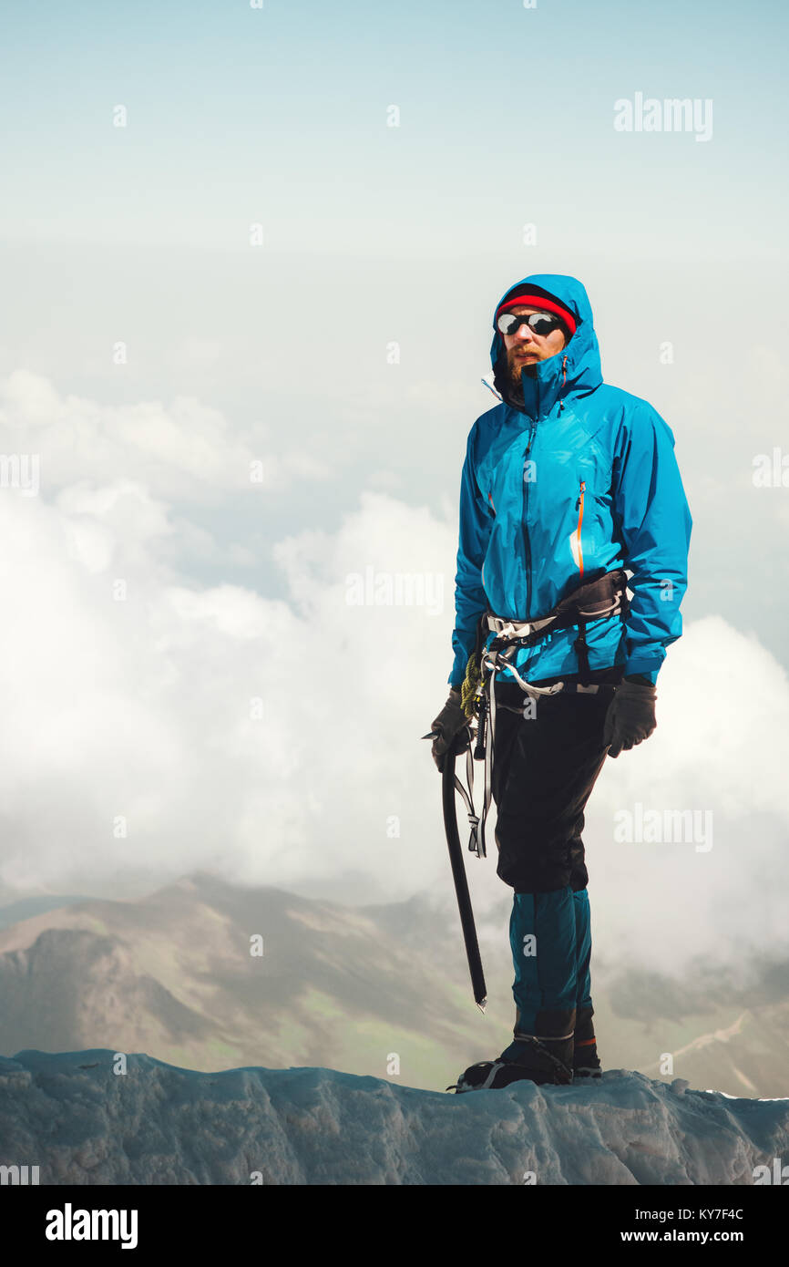 Man climber on mountain glacier Travel Lifestyle concept adventure active vacations outdoor mountaineering sport - Stock Image