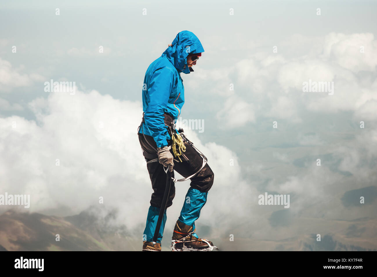 Man climbing to mountain summit Travel Lifestyle concept adventure active vacations outdoor mountaineering sport - Stock Image