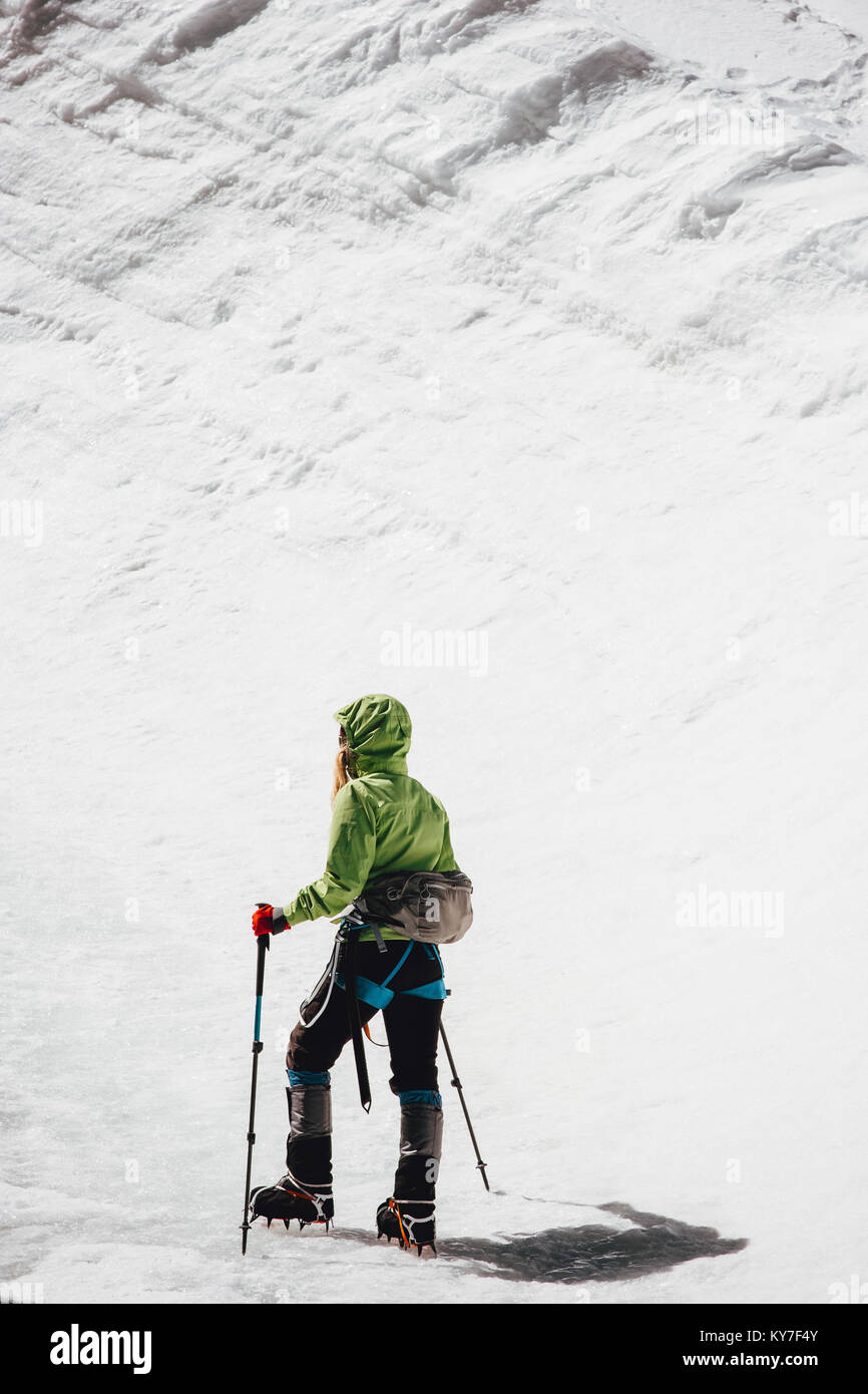Traveler climbing to mountain summit Travel Lifestyle concept adventure active vacations outdoor mountaineering - Stock Image