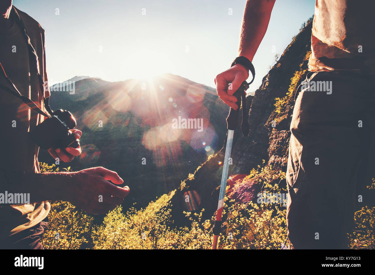 Hikers tourists traveling at sunset mountains outdoor Travel Lifestyle concept adventure active vacations hiking - Stock Image