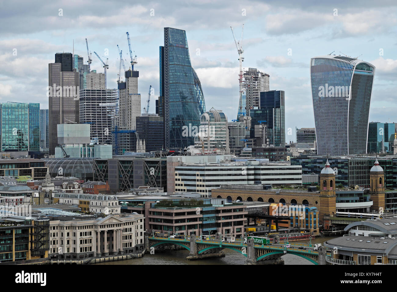 City of London skyline cityscape view of the financial district on a cloudy day with cranes and skyscrapers in 2017 - Stock Image