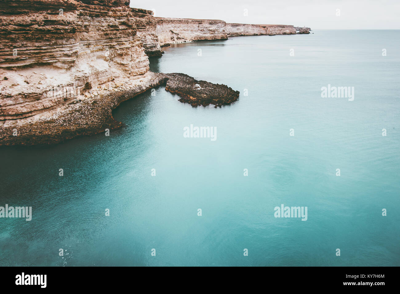 Blue Sea with rocky seaside Landscape calm and tranquility scenic view vacations travel - Stock Image