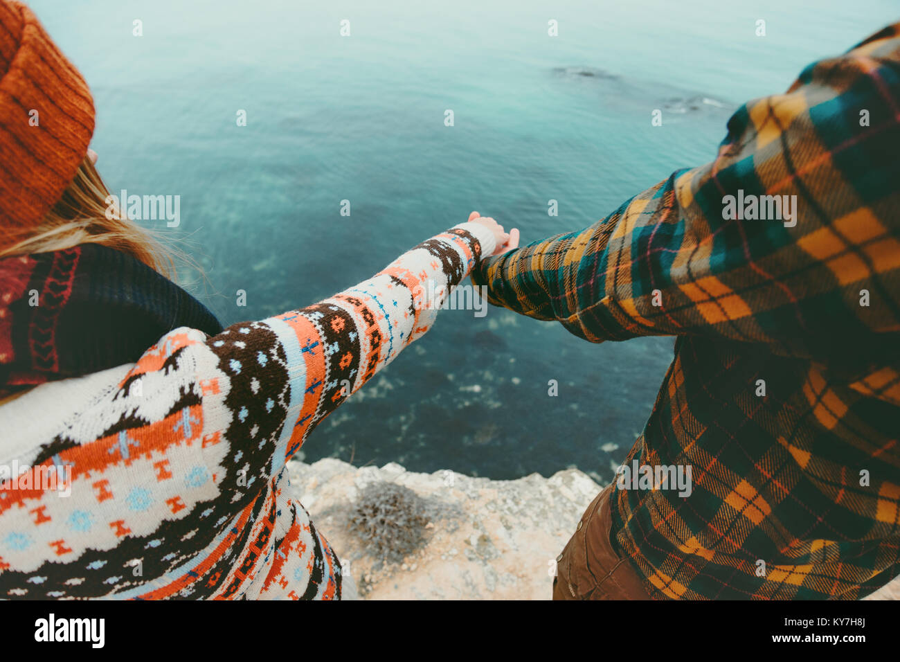 Couple in love holding hands Man and Woman Travel Lifestyle concept. Young family traveling romantic vacations autumn Stock Photo