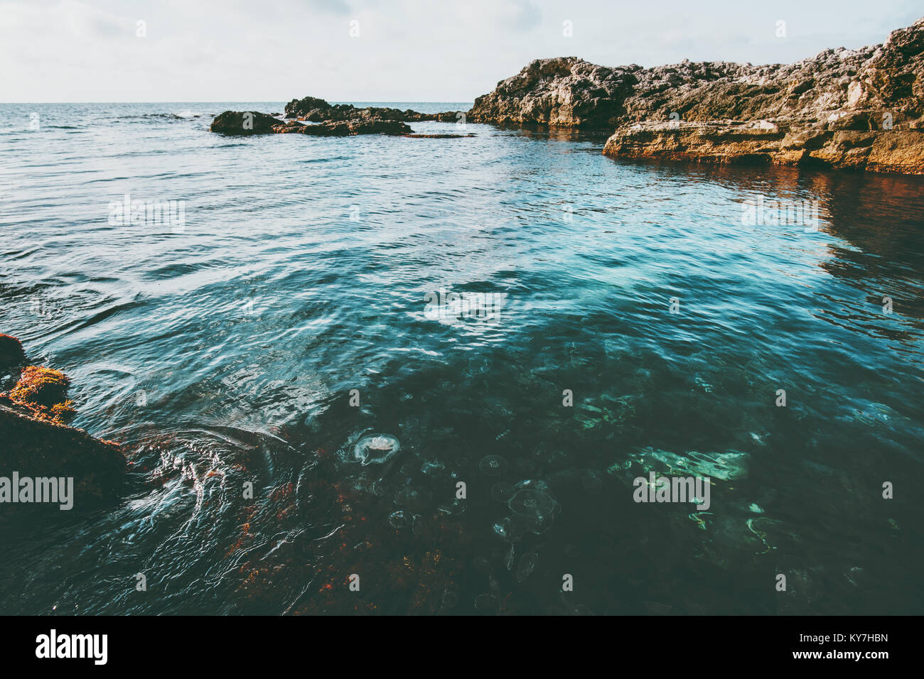 Blue Sea and rocky seaside Landscape calm idyllic scenic view vacations travel - Stock Image