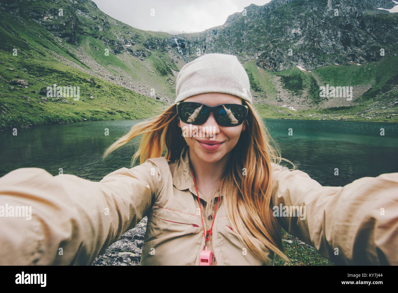 Woman traveler taking selfie hiking in mountains Travel Lifestyle adventure concept active summer vacations outdoor - Stock Image