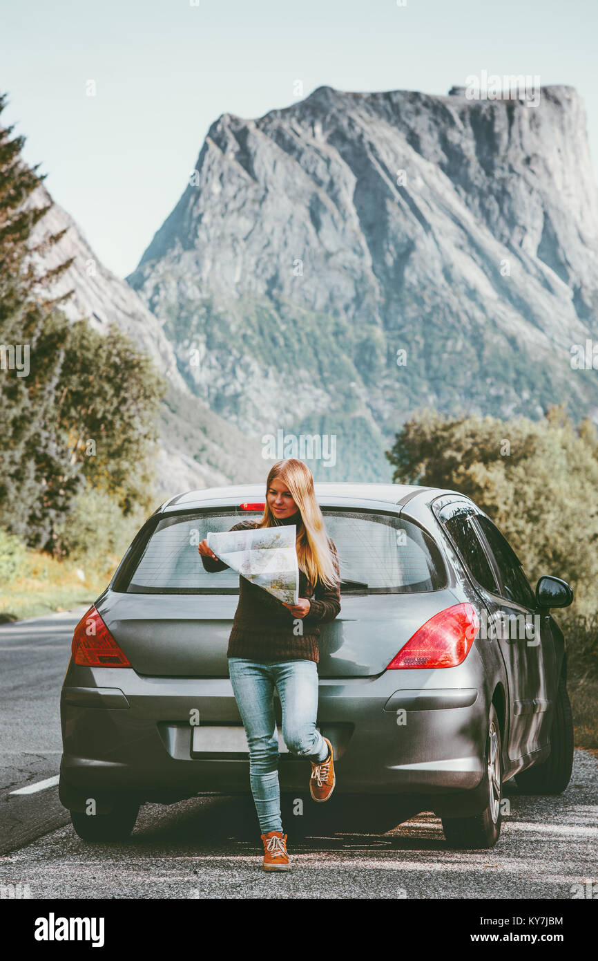 Young Woman traveling by rental car roadtrip with map in Norway Travel Lifestyle concept adventure weekend vacations Stock Photo