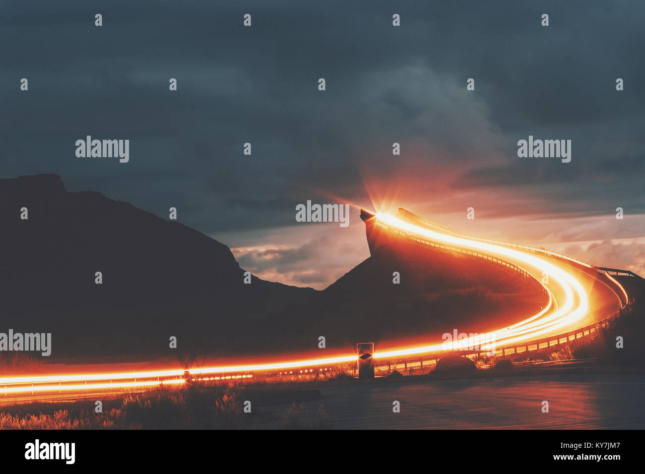Atlantic road in Norway night Storseisundet bridge over ocean way to sky scandinavian travel landmarks - Stock Image