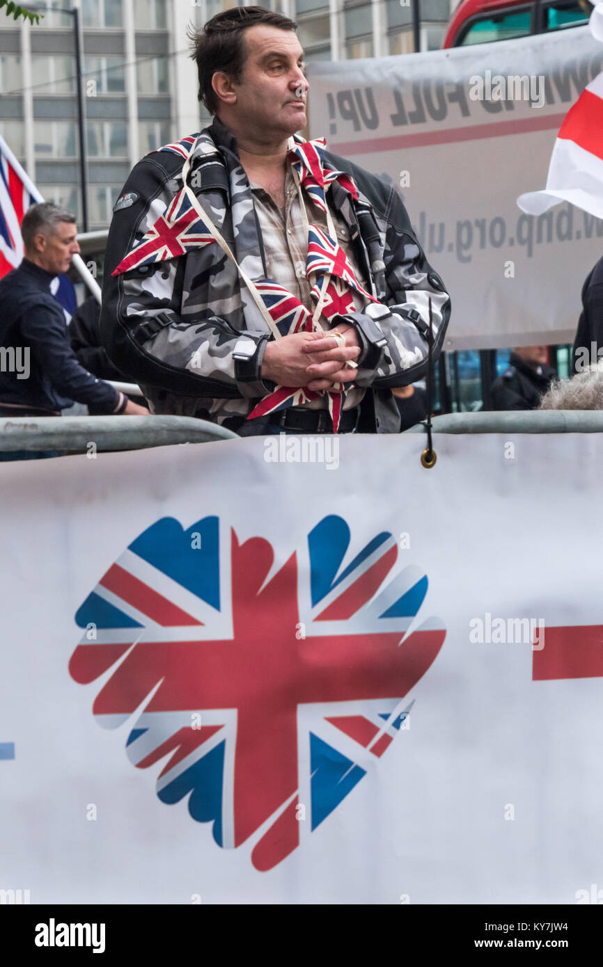 A BNP protester with Union Flags around his neck at the BNP 'No More Immigration' protest outside Lunar House, the Stock Photo