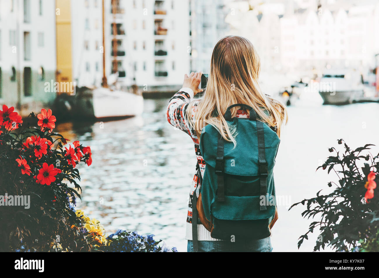 Woman with backpack walking in Alesund city Norway vacations weekend Travel Lifestyle fashion outdoor - Stock Image