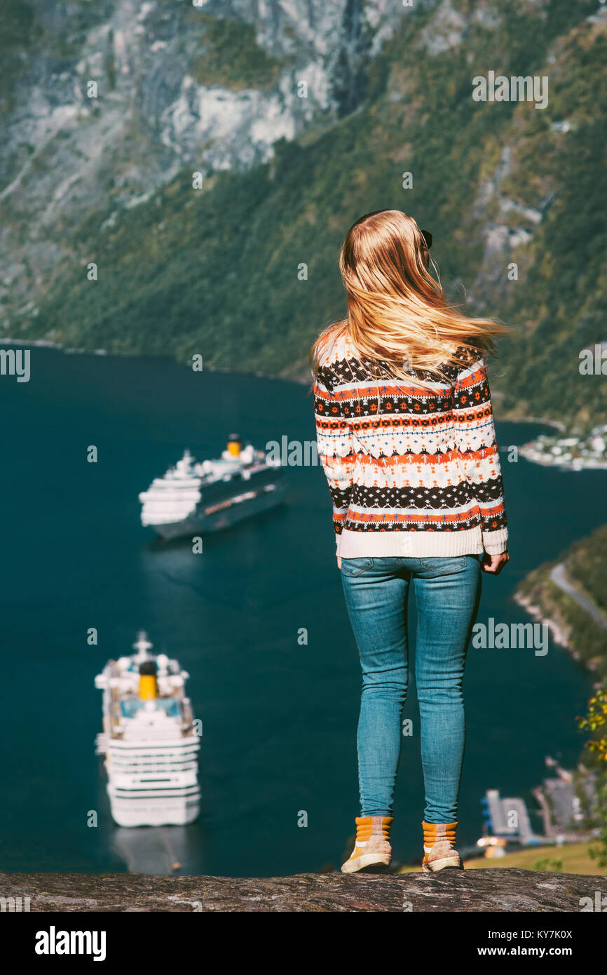Woman tourist walking over Geiranger fjord in Norway Travel lifestyle concept active weekend summer vacations  enjoying - Stock Image