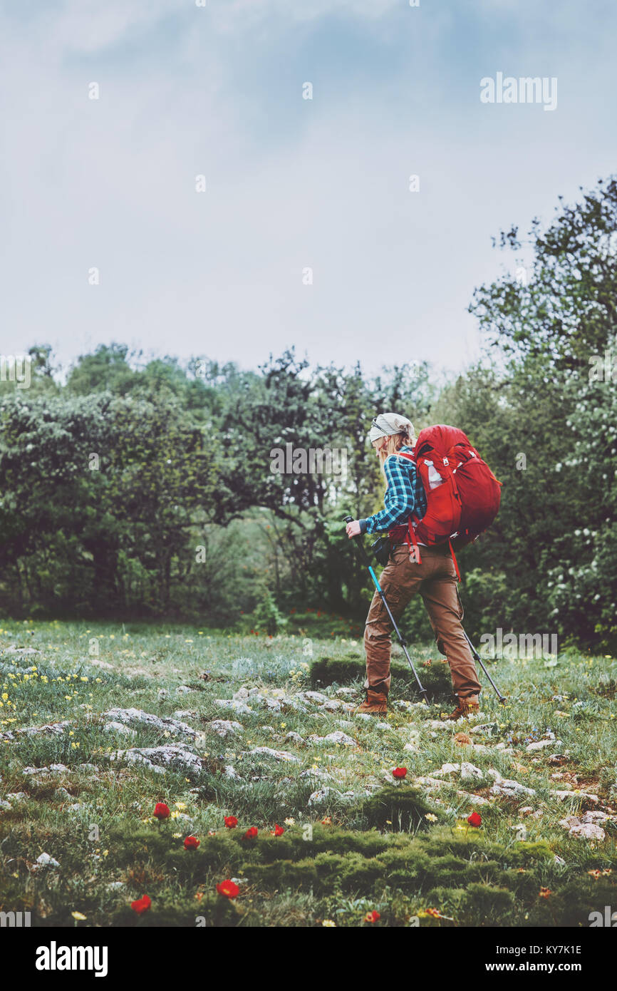 Tourist woman with backpack hiking Travel Lifestyle adventure concept summer vacations outdoor exploring wild nature - Stock Image