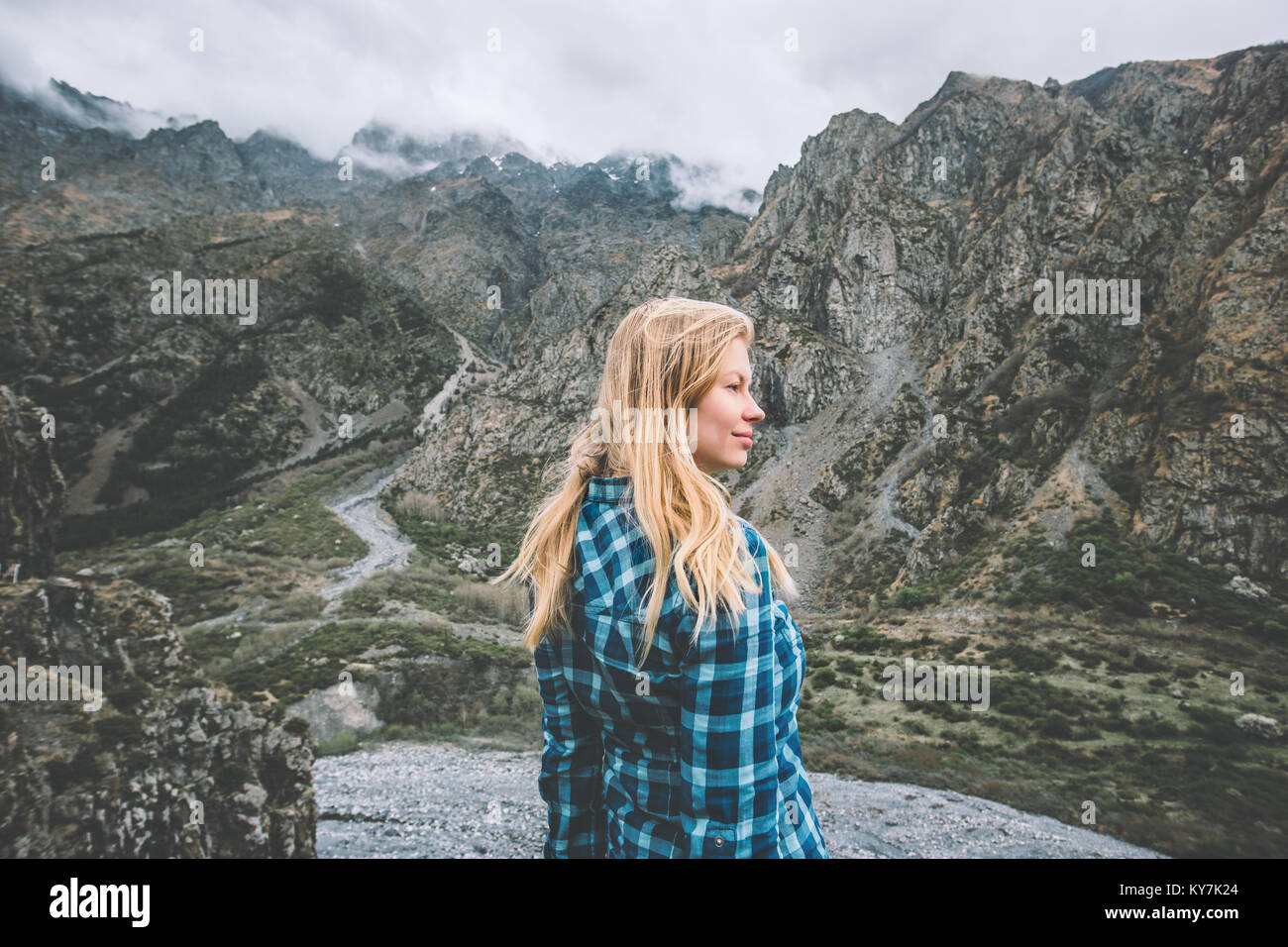 Woman tourist traveling in foggy mountains Lifestyle concept adventure vacations outdoor - Stock Image