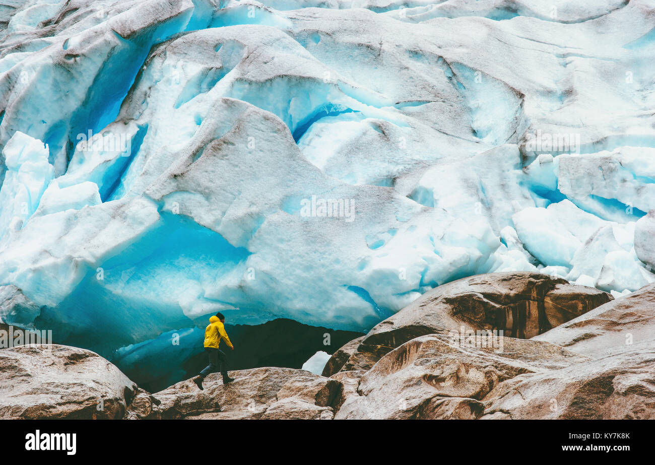 Man running at Nigardsbreen glacier  Travel Lifestyle ecology concept adventure extreme vacations outdoor nature - Stock Image