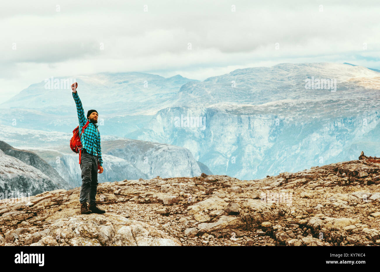 Man emotional happy raised hand Travel Lifestyle concept adventure vacations outdoor success and motivation scandinavian - Stock Image