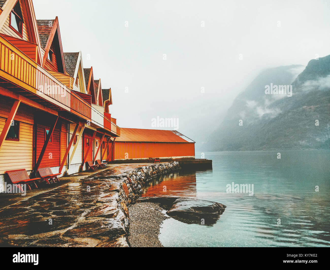 Cozy wooden country houses terrace exterior mountains and fjord view in Norway scandinavian style - Stock Image