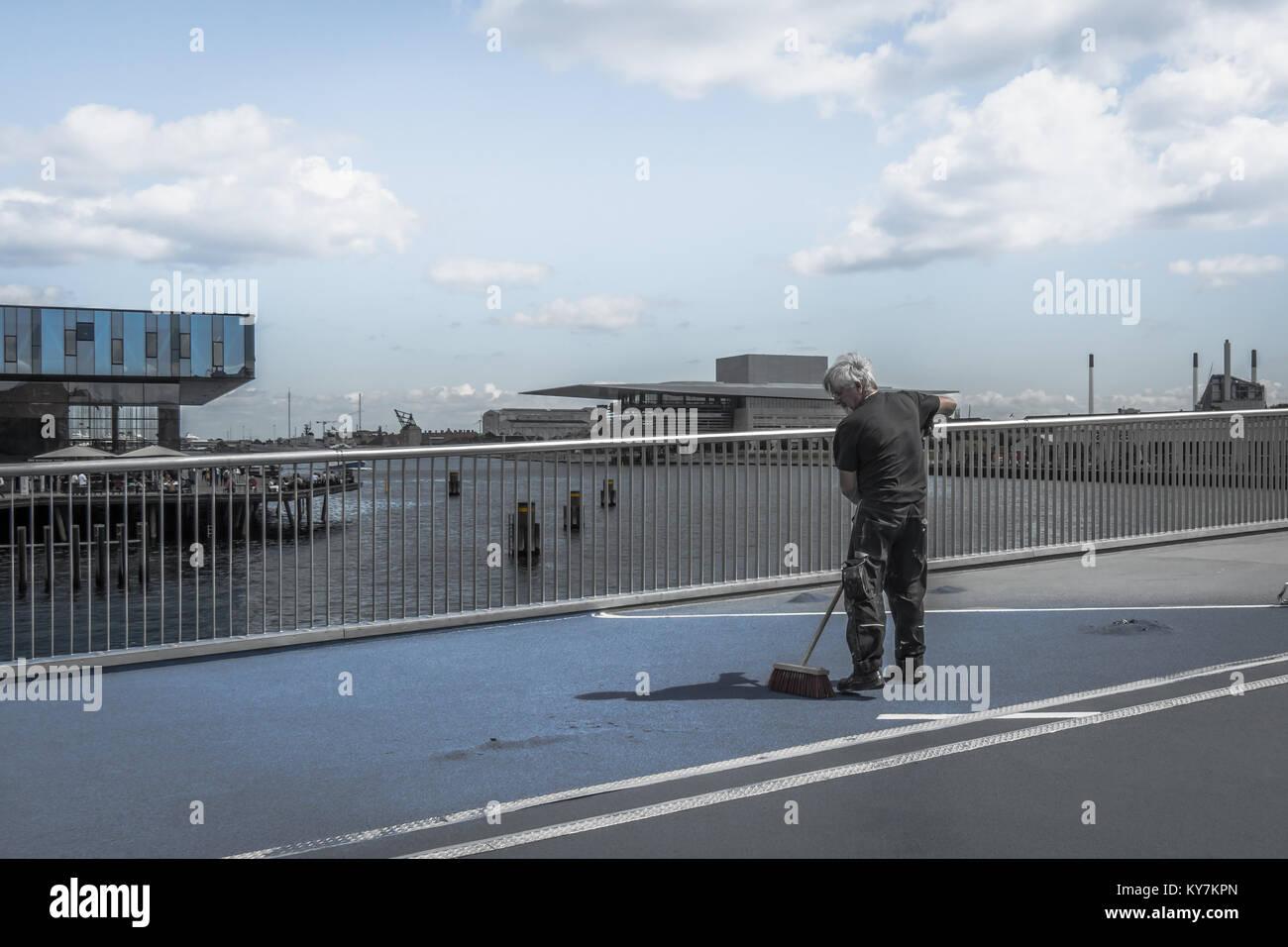Repairing the slippery surface of the inner port bridge in Copenhagen, Denmark, July 13, 2016 - Stock Image