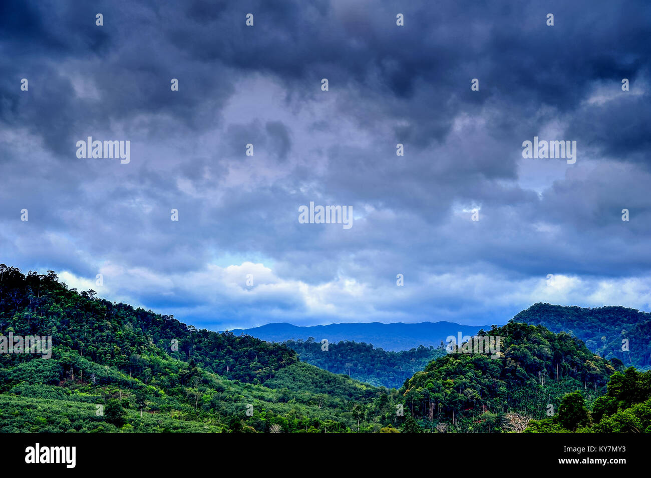 Rural view of mountain with raincloud - Stock Image
