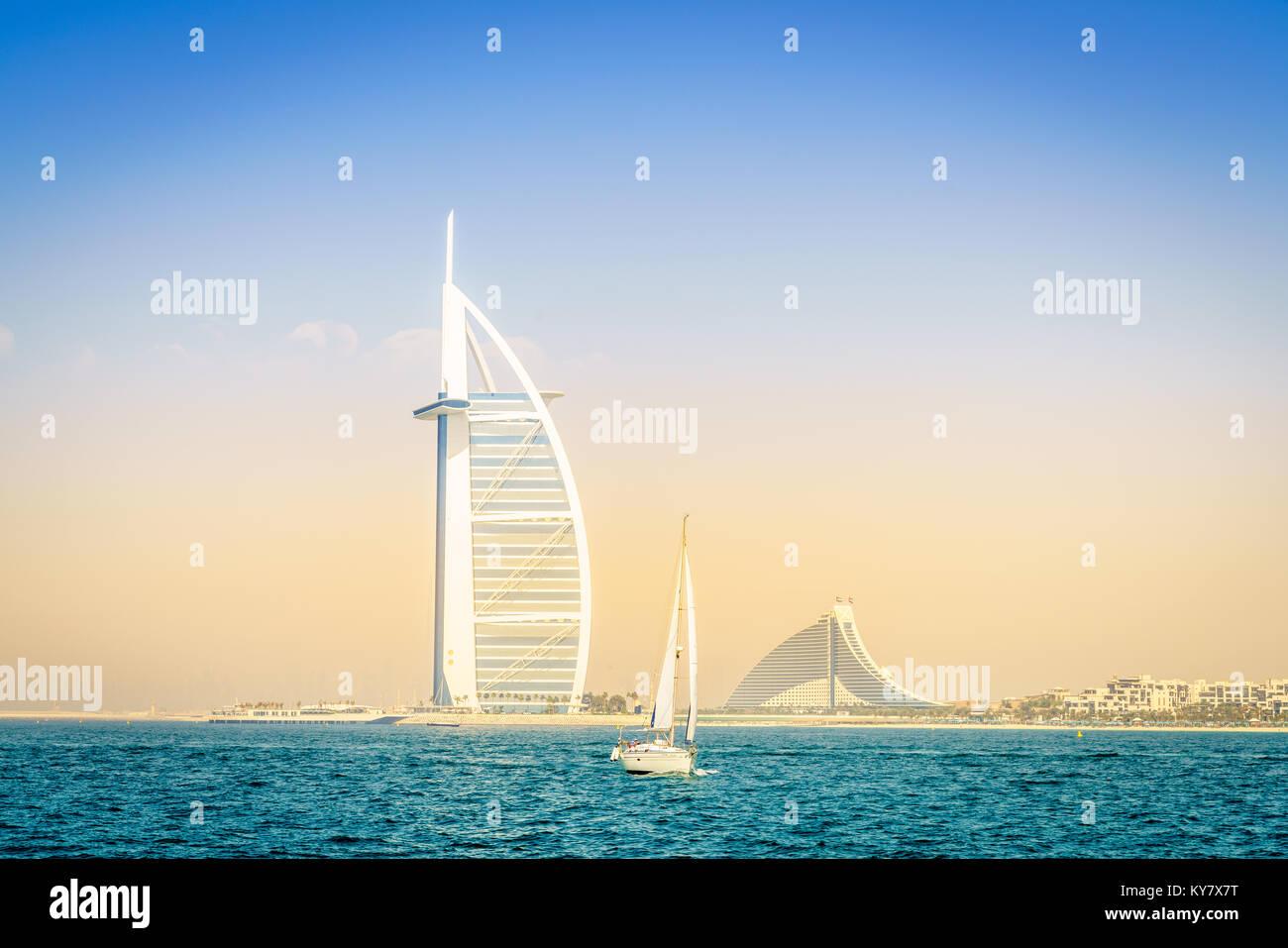 Dubai, UAE, March 31, 2017: seaside view of world's famous Burj Al Arab and Jumeirah Beach hotels - Stock Image
