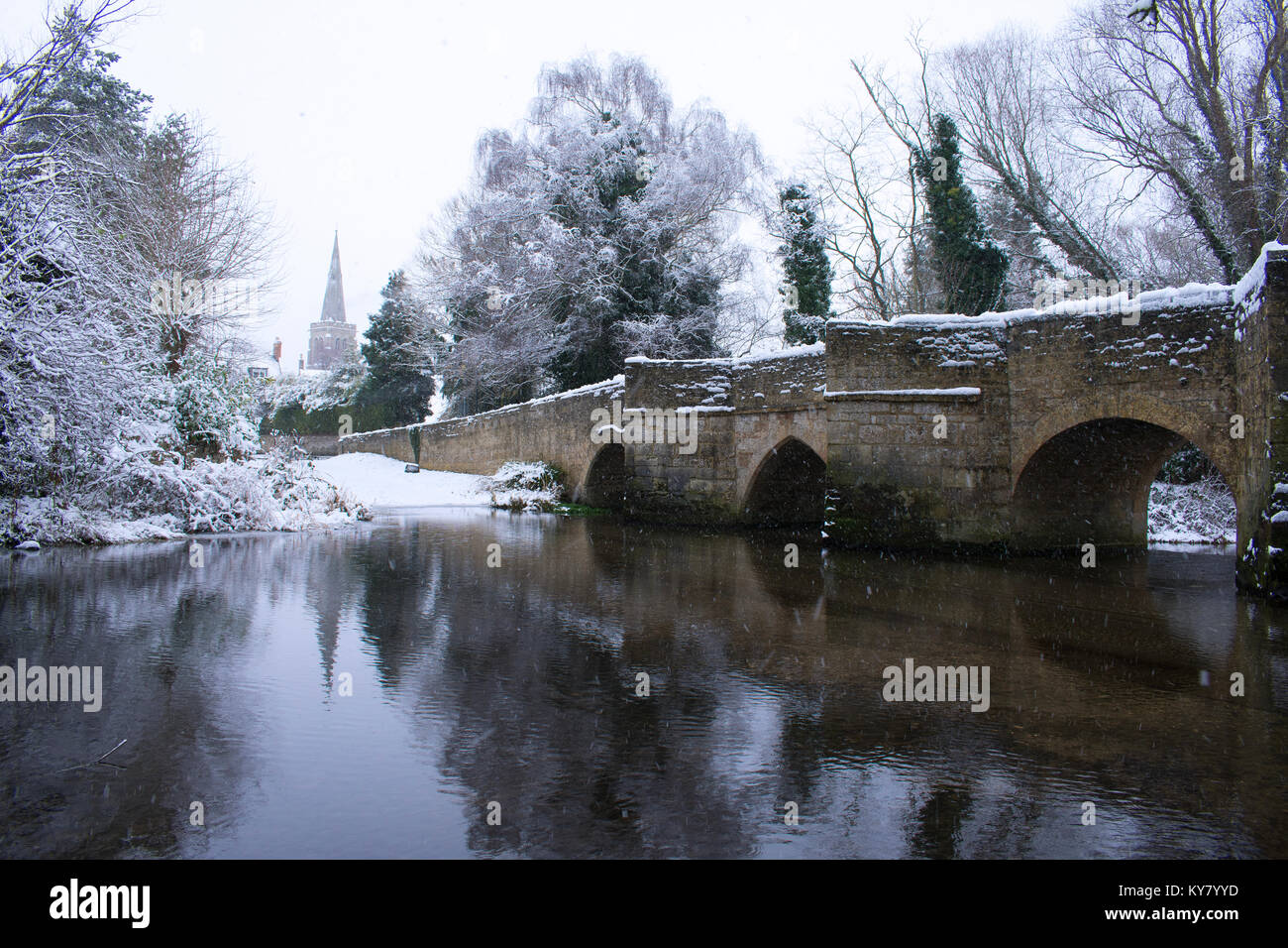 Snowy Scene in Geddington by the River Ise - Stock Image