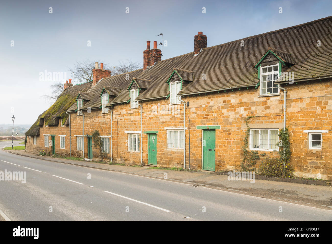 An image of a row of cottages in the small picturesque village of Rockingham, Northamptonshire, England, UK. - Stock Image