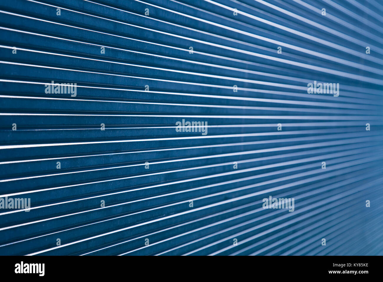 Abstract composition showing parallel, converging lines made from a stack of thick glass panes. - Stock Image