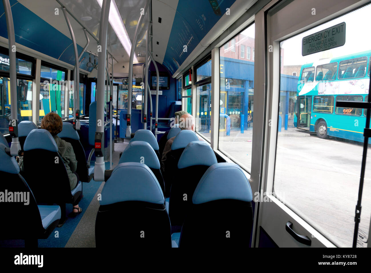 Passengers sitting on an Arriva bus waiting for it to leave North Road bus station, Durham, England - Stock Image