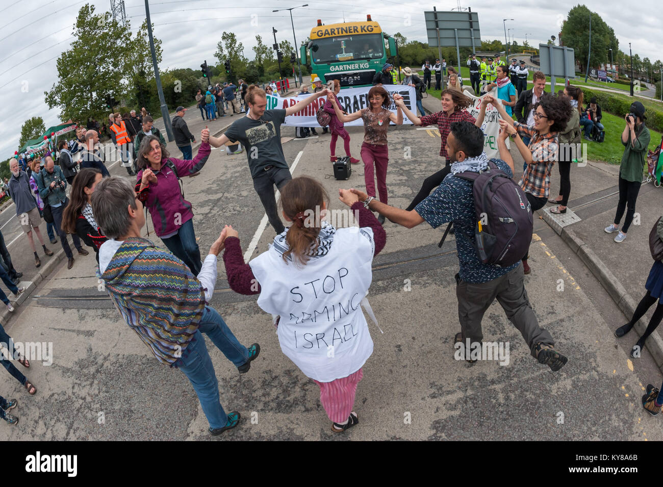Dabke dancing on the road in front of a stopped lorry at 'Stop Arming Israel', the first day of a week of action Stock Photo