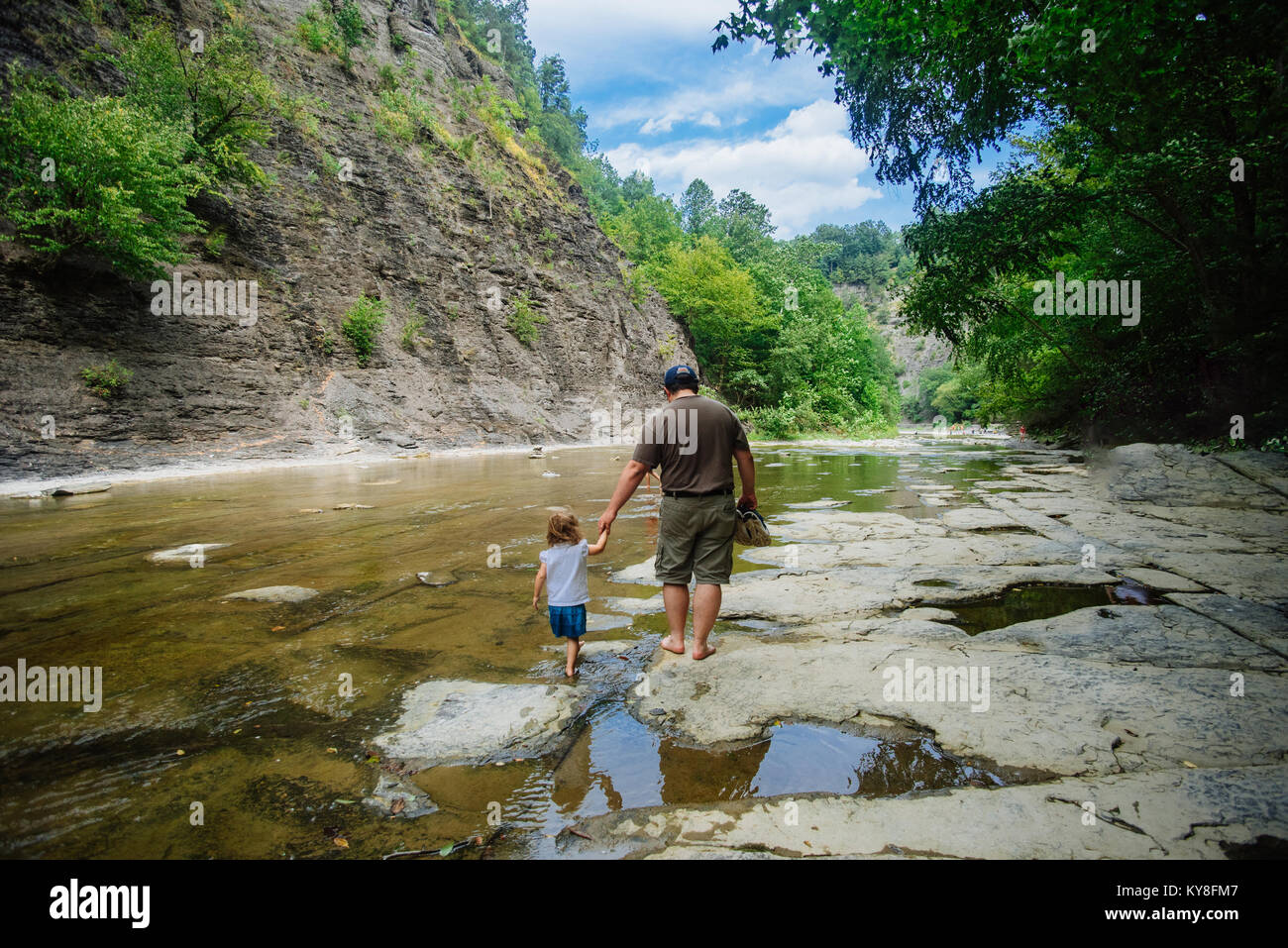 A family walks together in a state park in the United States Stock Photo
