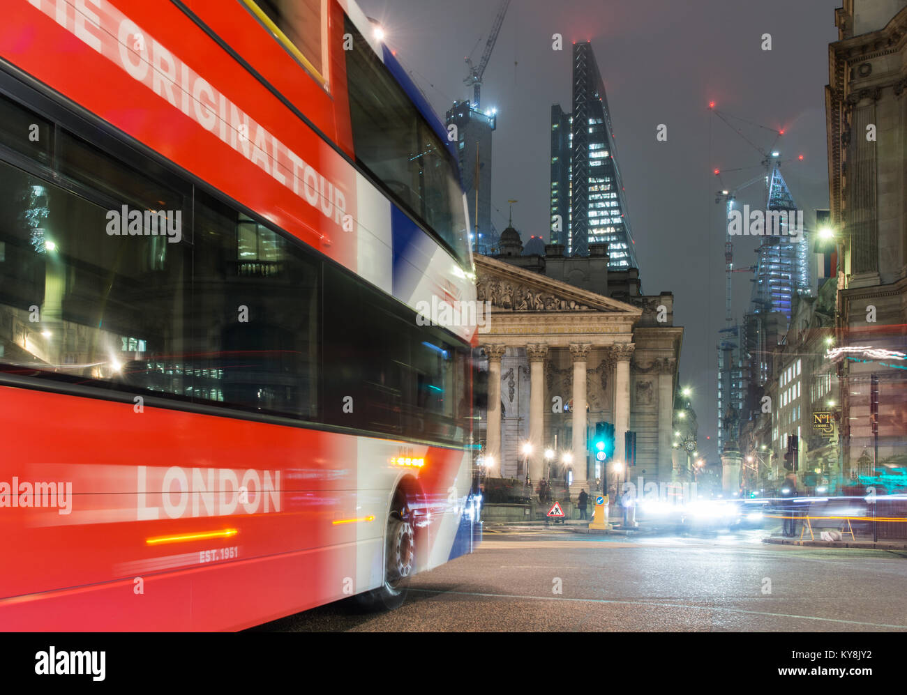 London, England, UK - January 11, 2018: A double-decker tour bus passes through Bank Junction in the City of London, - Stock Image