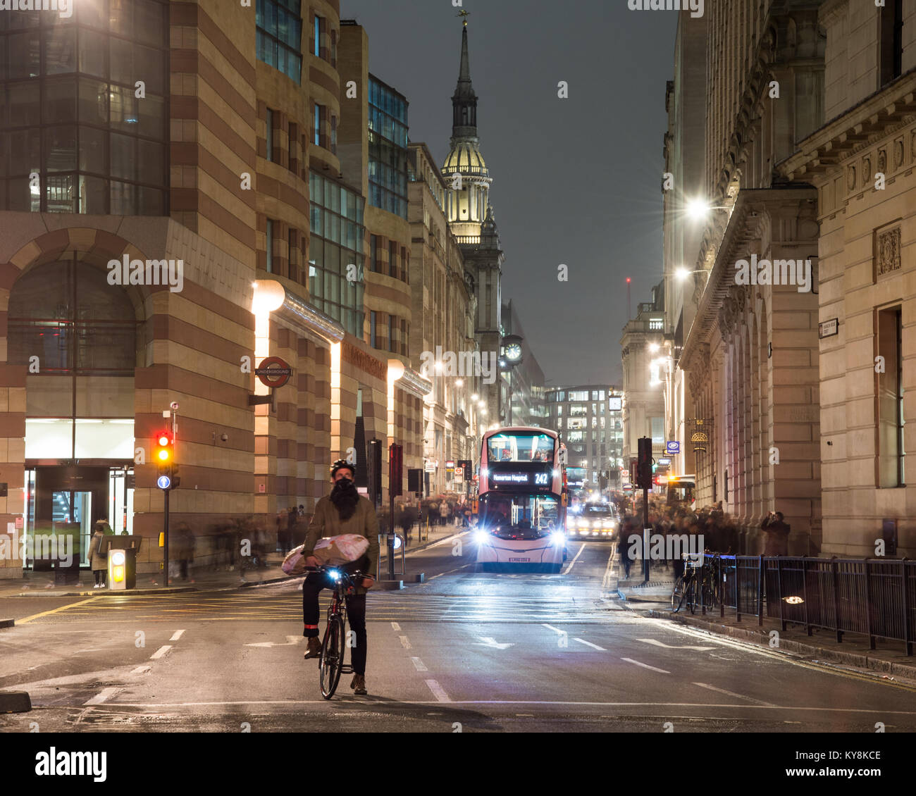 London, England, UK - January 11, 2018: Pedestrians walk past cyclists and buses waiting at Bank Junction in the - Stock Image