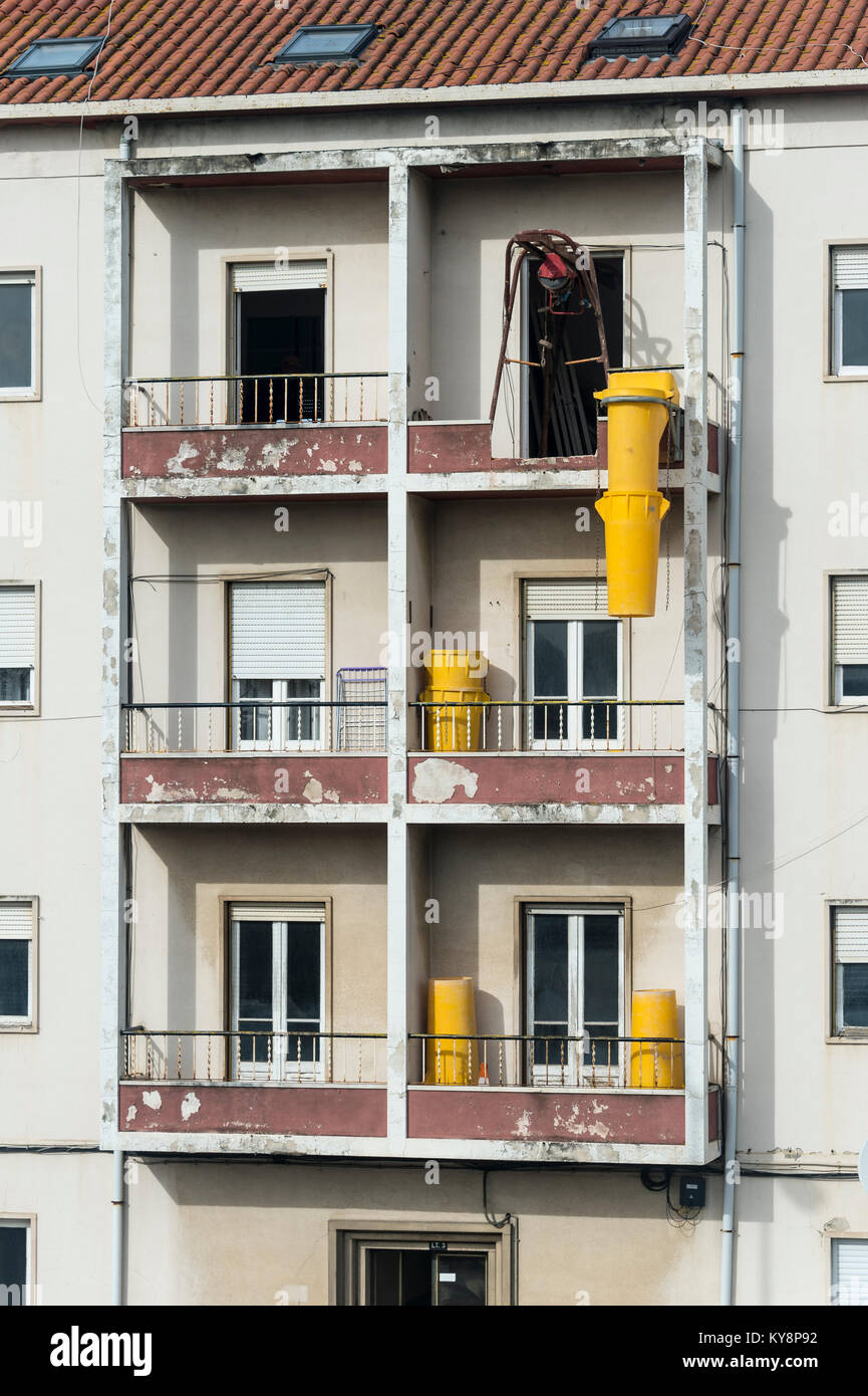 apartment building undergoing renovation and refurbishment. - Stock Image