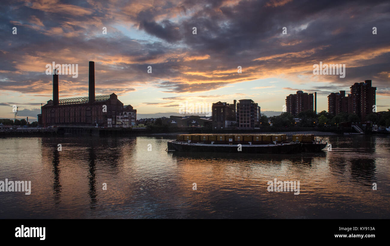London, England, UK - August 12, 2014: The chimneys of Lots Road Power Station and the Worlds End council estate - Stock Image