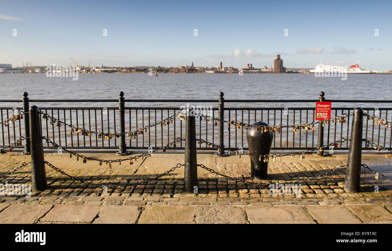 Liverpool, England, UK - November 5, 2014: Padlocks left by couples cover a fence along the shores of the River - Stock Image
