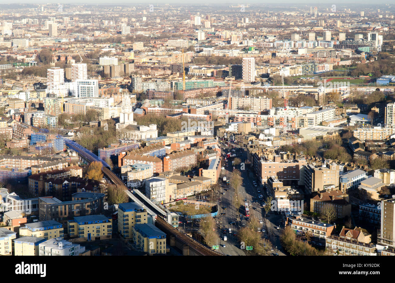Looking down on London's East End neighbourhoods of Westferry, Limehouse and Mile End from the Docklands Canary - Stock Image