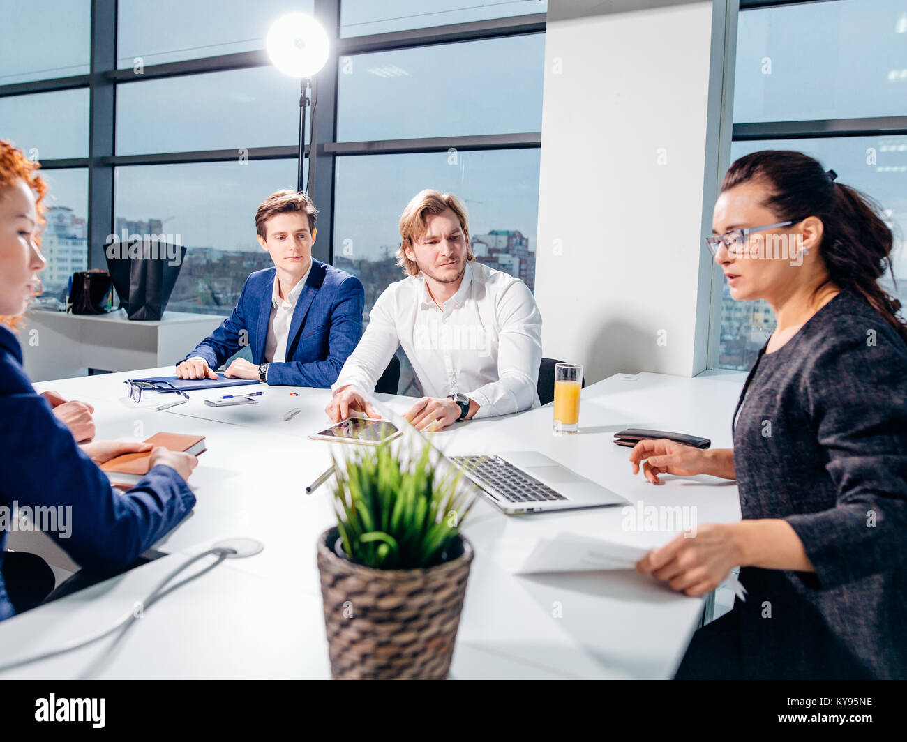 Manager Leads Brainstorming Meeting In Design Office - Stock Image