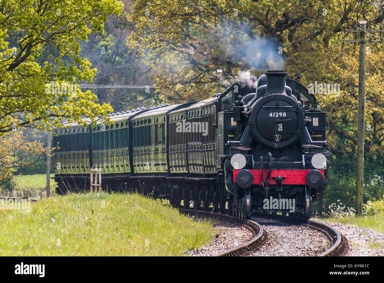 Preserved  Ivatt Class steam locomotive, steaming through the Isle of Wight countryside. Heritage railway with Victorian - Stock Image