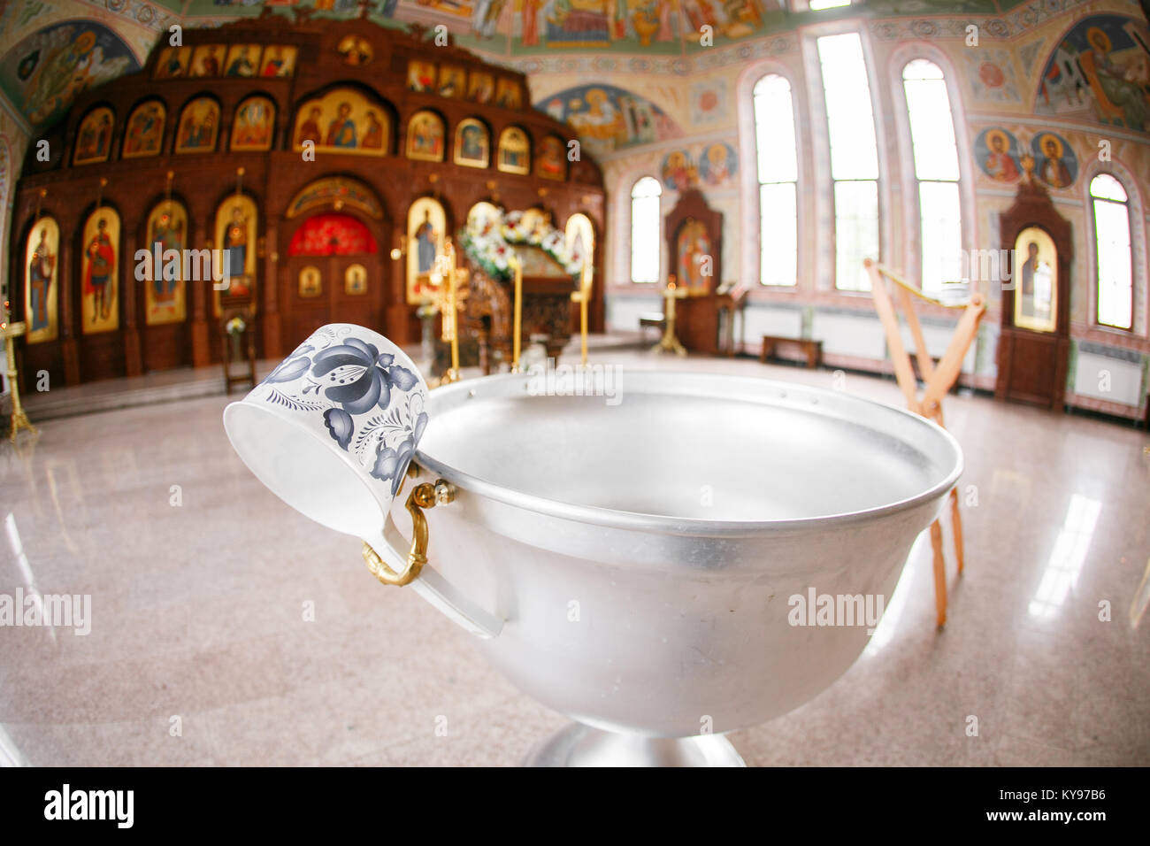 Accessories for the christening of children icons of candles and font, the Ortodox Church. The Sacrament of Children - Stock Image