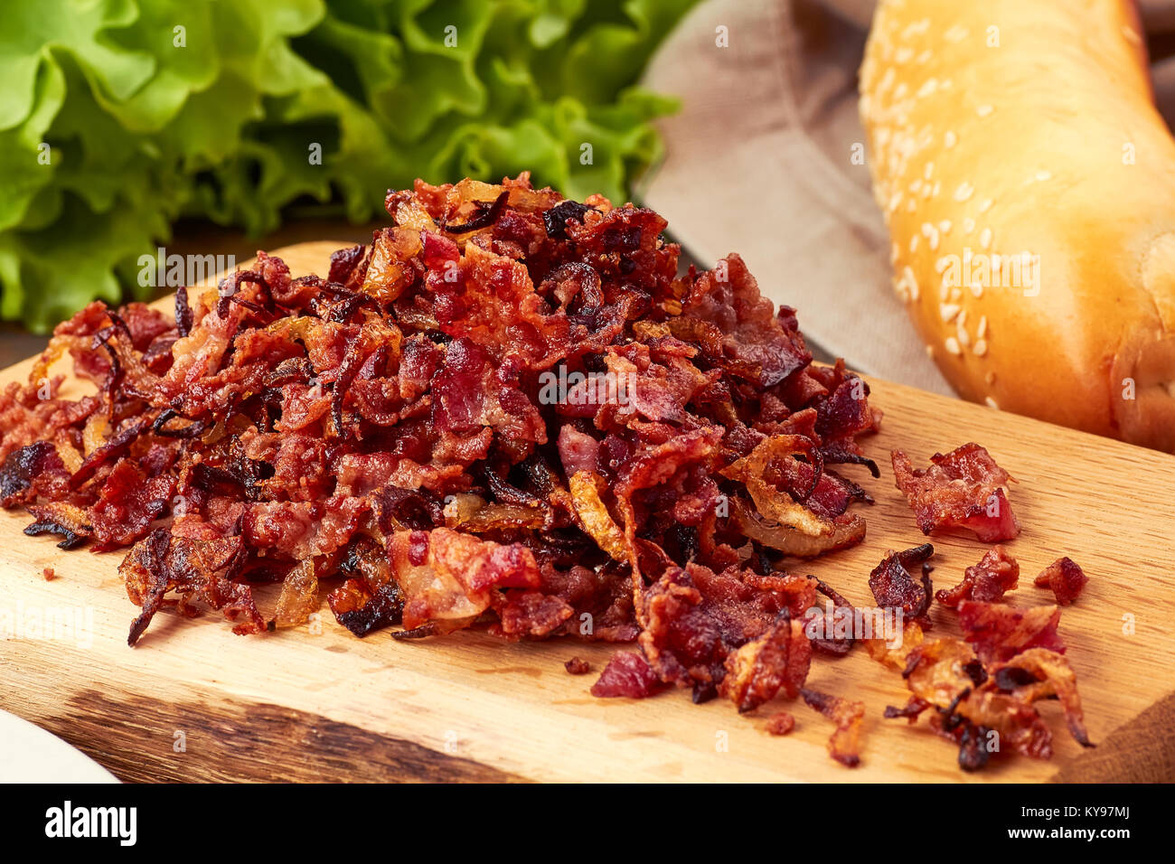 Heap of bacon and onion toppings - Stock Image
