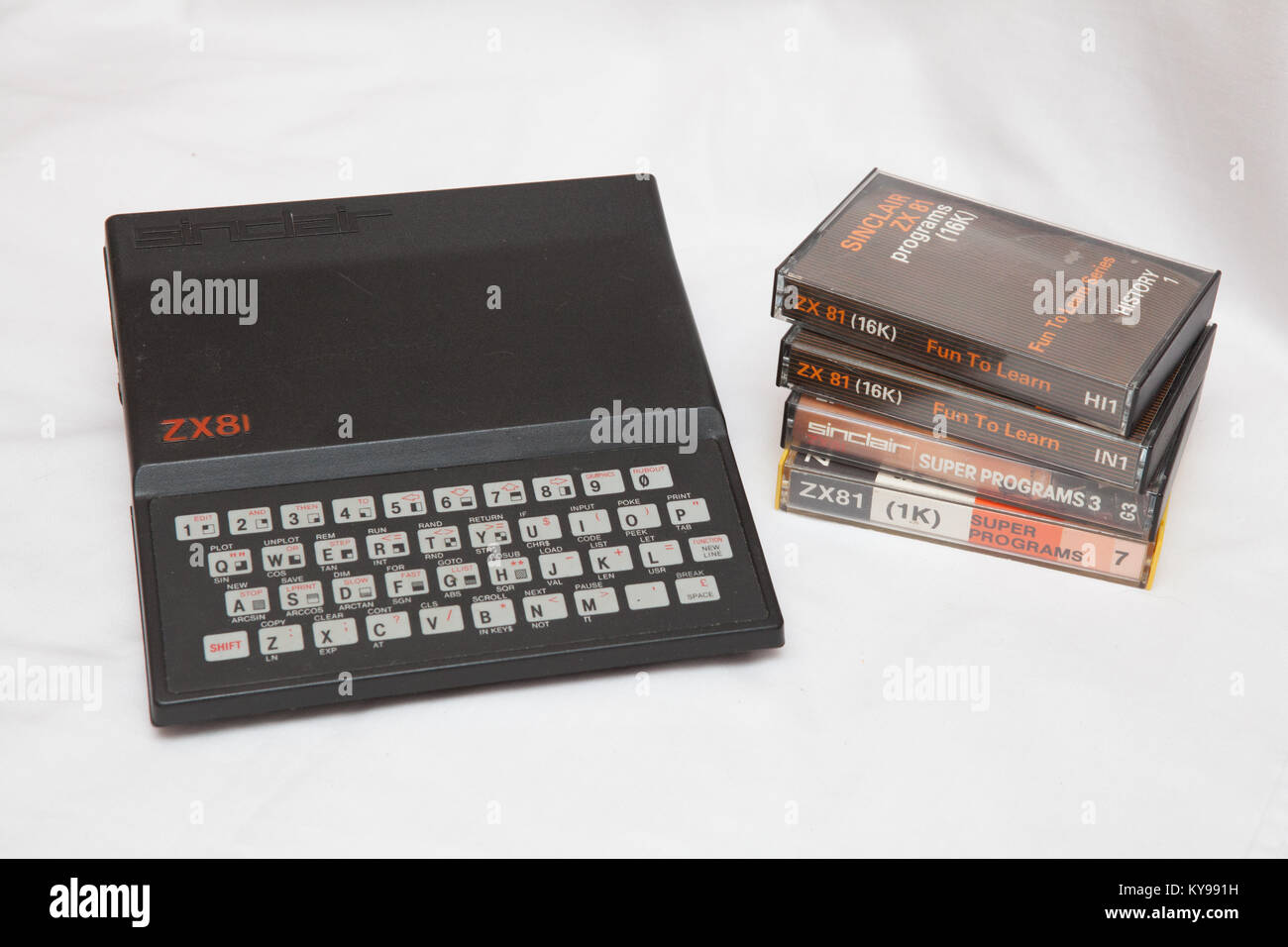 Sinclair Research ZX81 home computer with associated cassette tapes - Stock Image