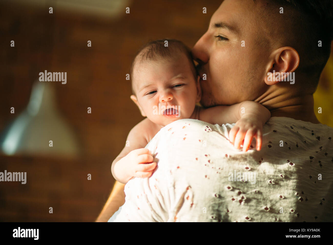 young father holding his newborn baby son - Stock Image