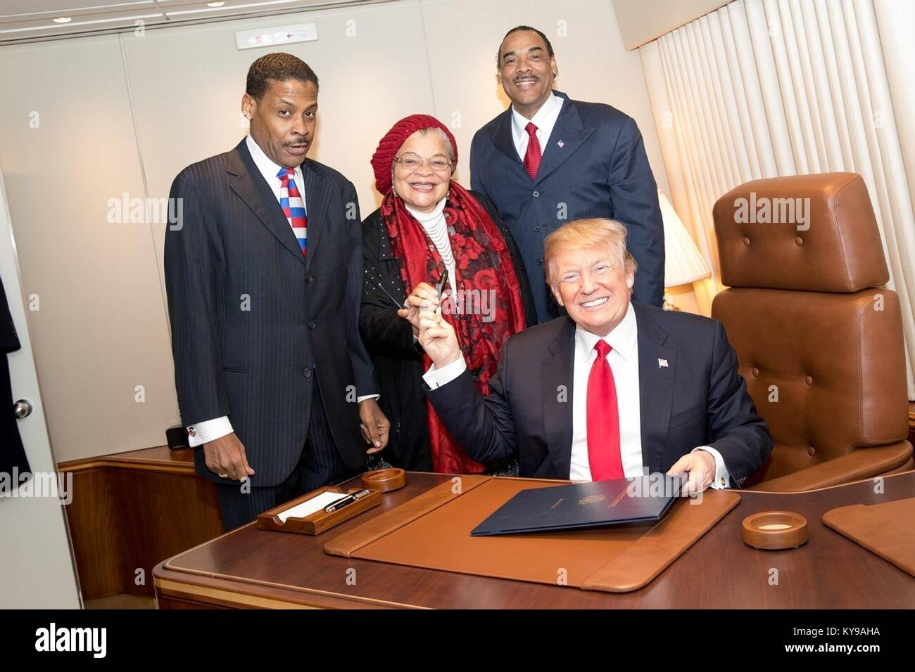 U.S. President Donald Trump hands the pen used to sign the Martin Luther King Jr. National Historical Park Act to - Stock Image
