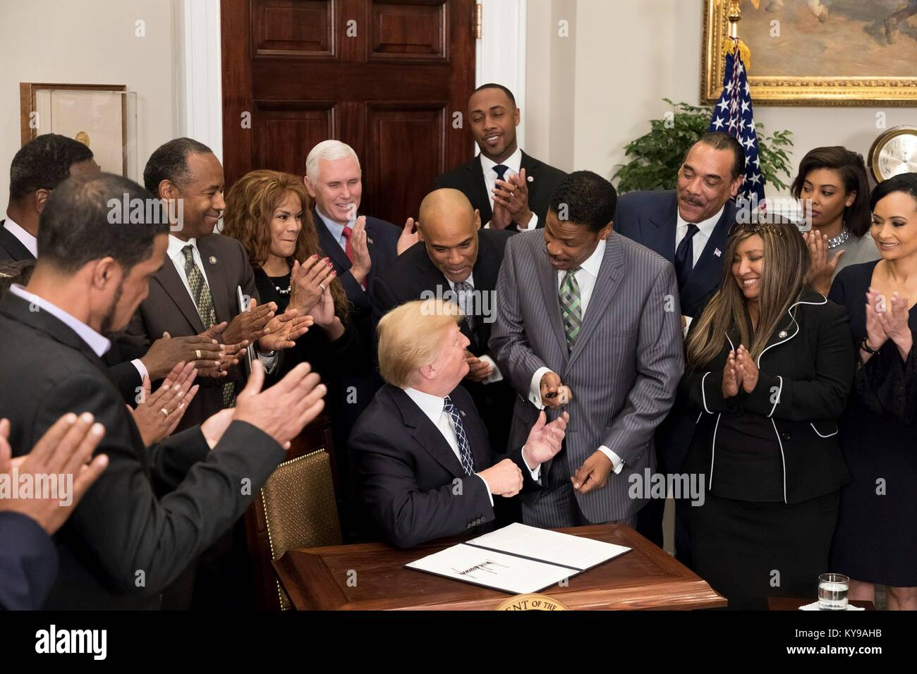 U.S. President Donald Trump hands the pen used to sign a proclamation to honor Dr. Martin Luther King, Jr. Day to Stock Photo