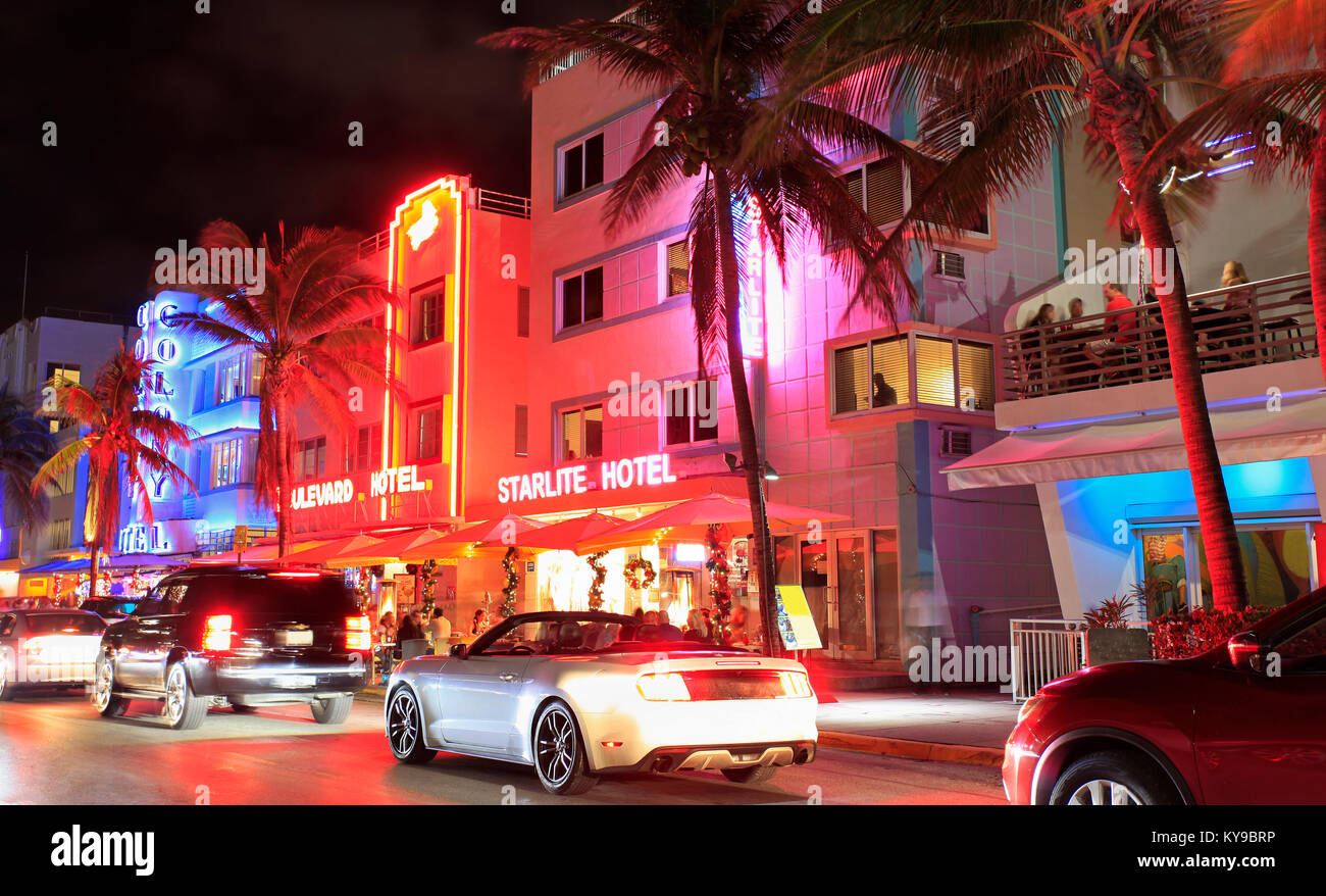 Ocean Drive Art Deco buildings illuminated at dusk in Miami Beach - Stock Image