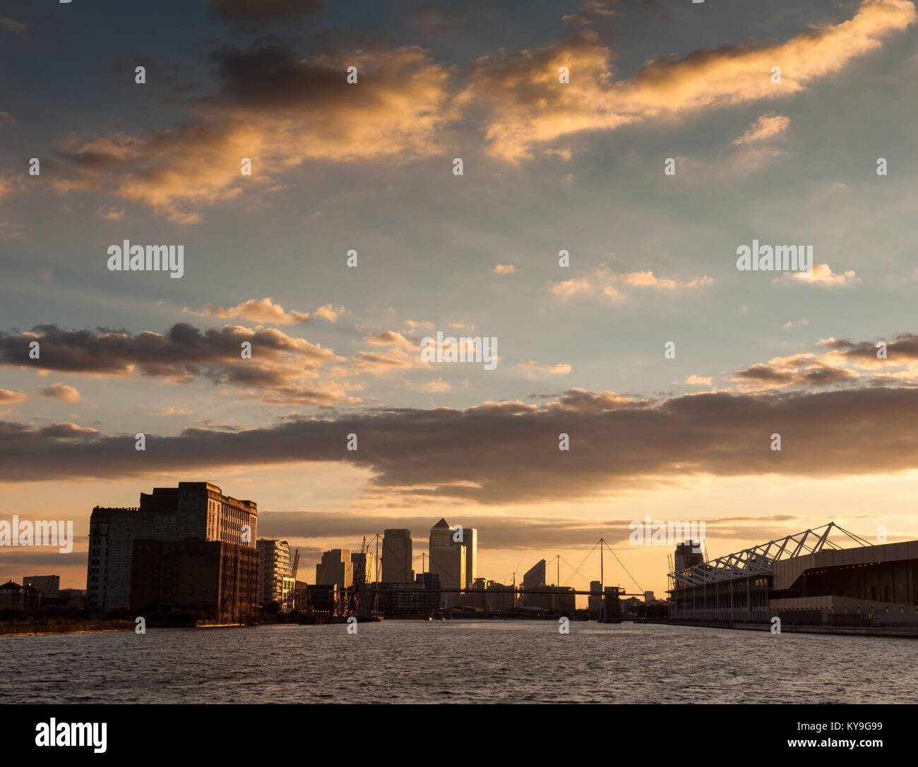 London, England, UK - July 31, 2010: Sunset casts a red sky across London's Docklands financial district and - Stock Image