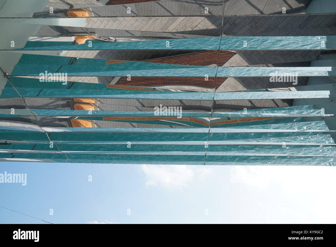 looking up at reflections in glass surface - Stock Image
