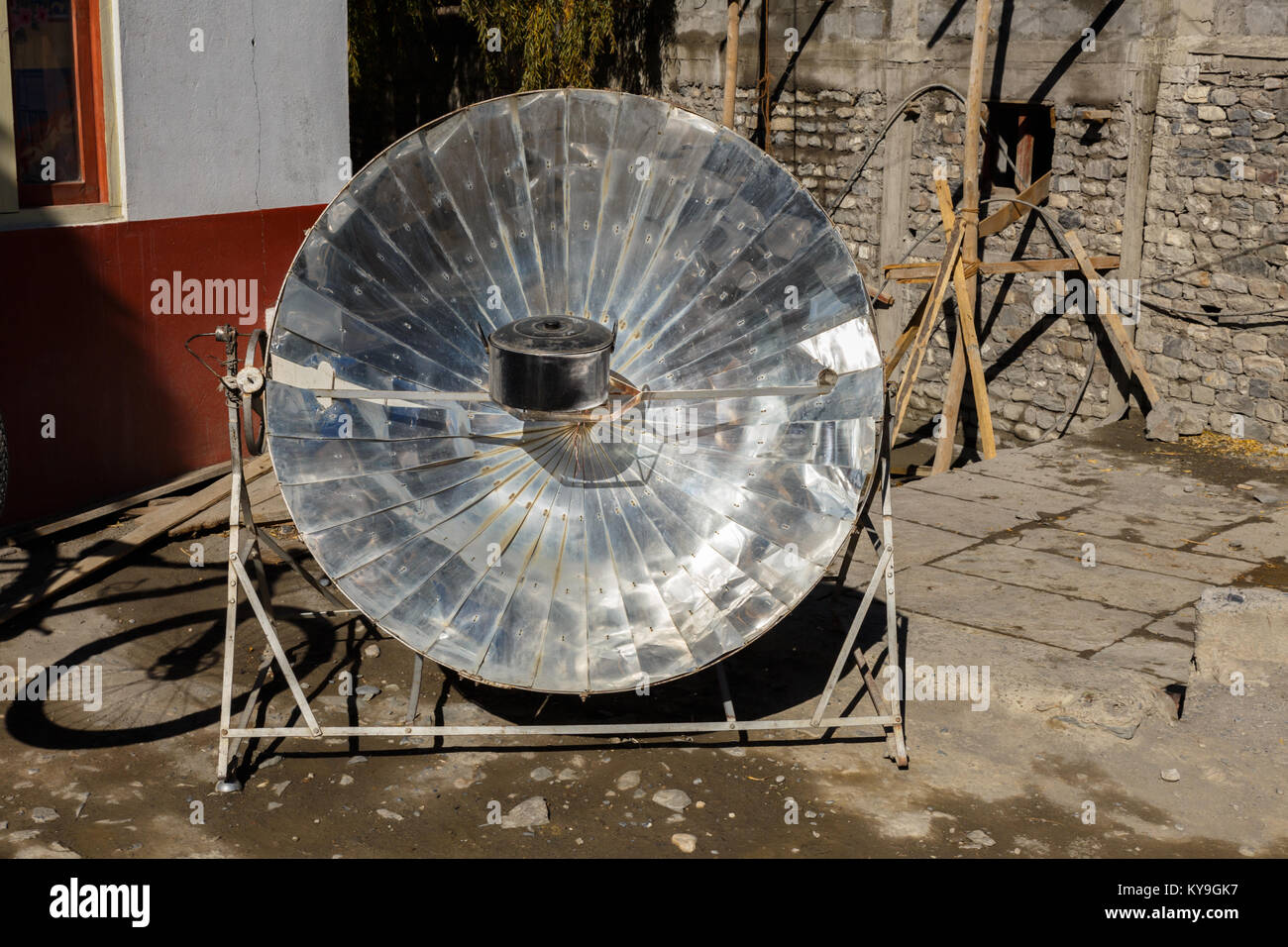 Eco-friendly solar heater for boiling water in the himalayan mountains in Nepal. - Stock Image