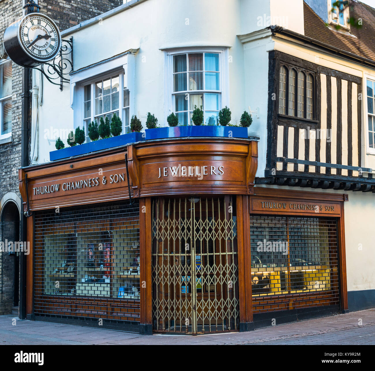 UK England, Suffolk, Bury St Edmunds, Abbeygate Street jeweller with shutters up on a Sunday, in historic timber - Stock Image