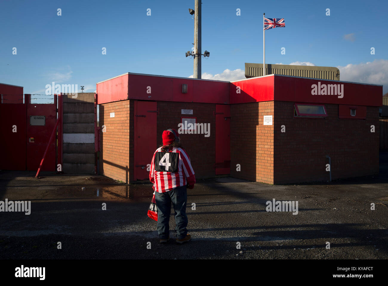 Enjoyable A Solitary Home Supporter Waiting Outside A Turnstile Download Free Architecture Designs Scobabritishbridgeorg