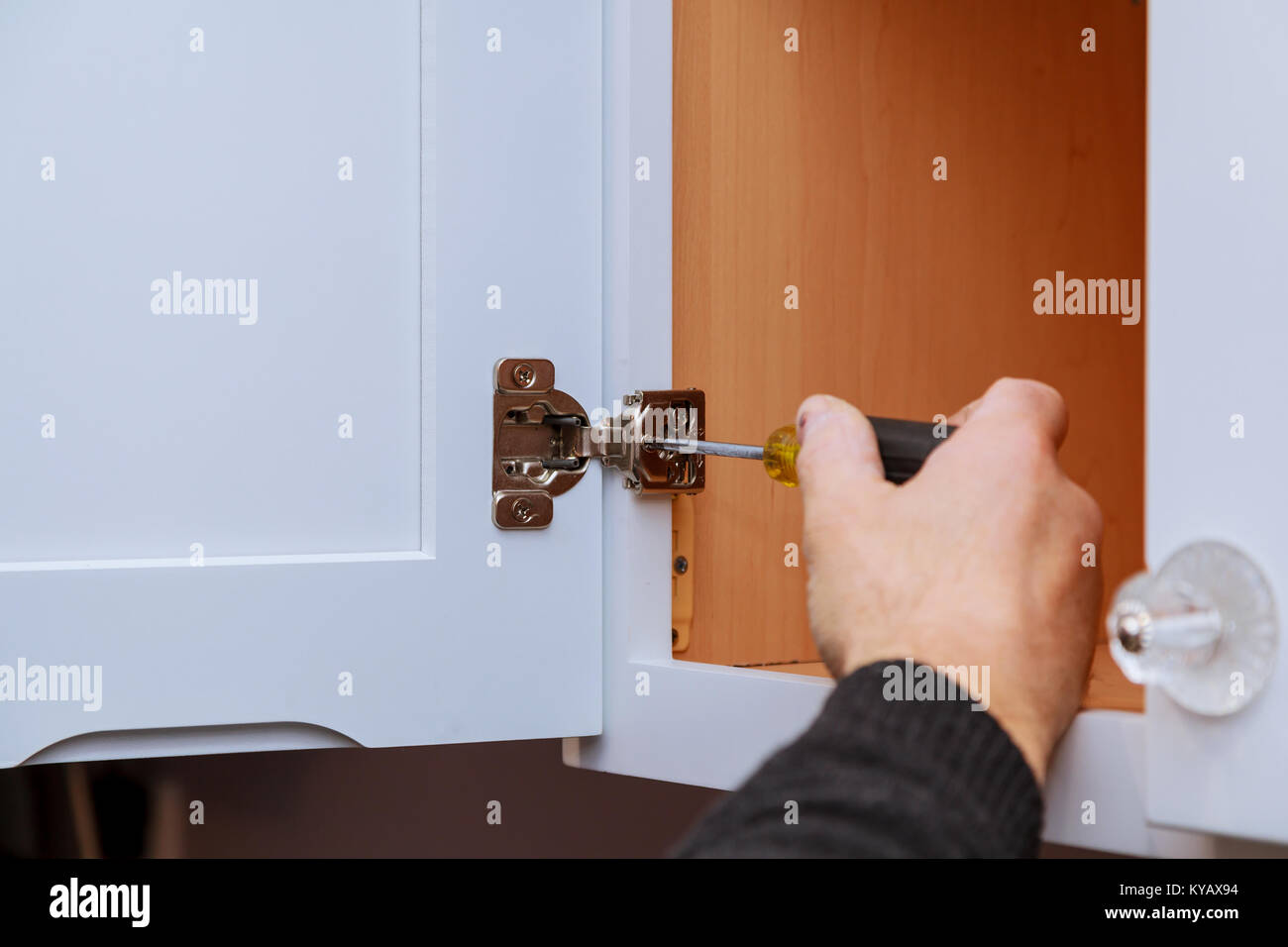 Adjusting Fixing Cabinet Door Hinge Adjustment On Kitchen Cabinets Stock Photo Alamy